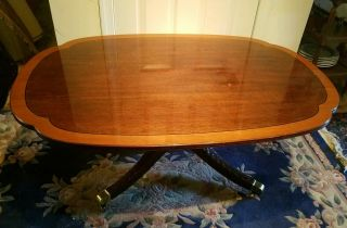 Signed Stickley Cherry Banded Top And Carved Base Coffee Table.