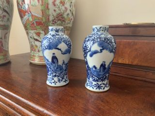 A Fine Quality 19thc Chinese Blue And White Figural Baluster Vases.
