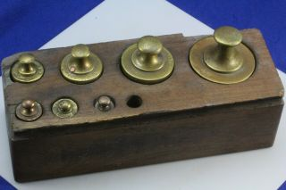 Antique Balance Scale Weights In Wood Block.