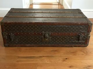 Early 20th Century Louis Vuitton Wardrobe Trunk Hand Stenciled Monogram Pattern.
