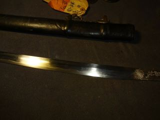 E 02 Japanese WWll Naval officer ' s sword in mountings,