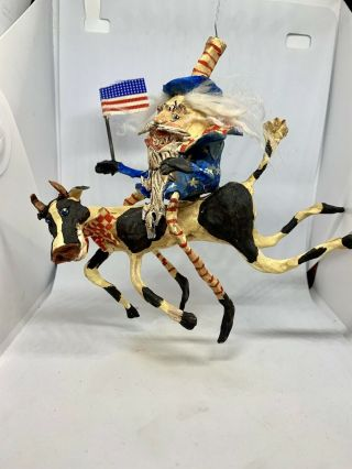 Primitive Handsculpted Primitive Uncle Sam & Flag Riding Cow With Bow Tie 7""