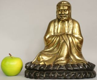 A Chinese Bronze Gilt Figure Of Bodhidharma Daruma Arhat,  Wood Stand 19th/20thc