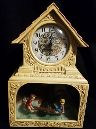 """Haddon Electric Novelty Clock """" The Teeter Totter """" Lighted Motion"""