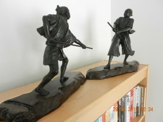 Japanese Bronzes Of A Samurai & Peasant With Weapons