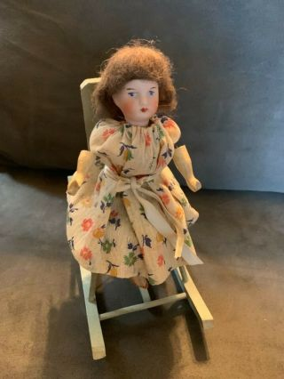 Vintage Mechanical Little Bisque Doll In A Rocking Chair