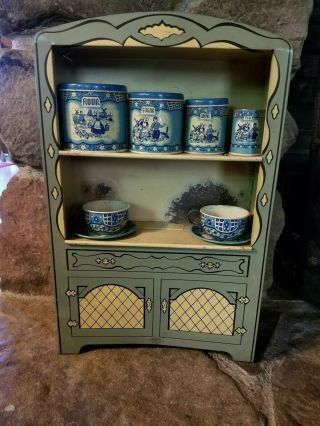 Vintage 1950s Wolverine Kitchrn Cabinet With Canisters And Cups And Saucers