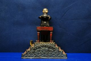 "Antique Cast Iron Mechanical Bank – J.  & E.  Stevens – ""magician Bank"""