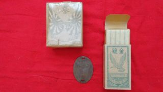 Japanese Dog Tag And Cigarettes.