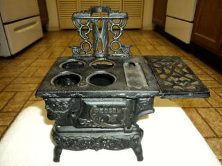 Vintage Cast Iron Miniature Wood Burning Stove By Crescent W/.