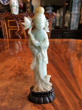 A Rare Chinese Qing Dynasty Carved Jadeite Guanyin Statue With Wooden Stand.