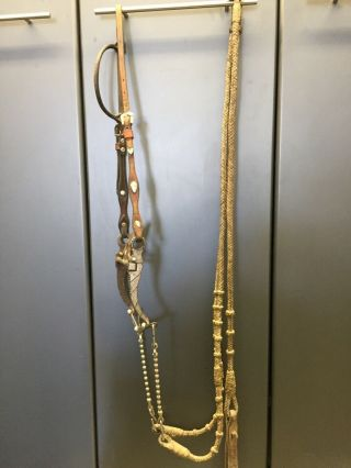 Vintage Silver Spade Bit,  Headstall And Rawhide Reins And Romel.