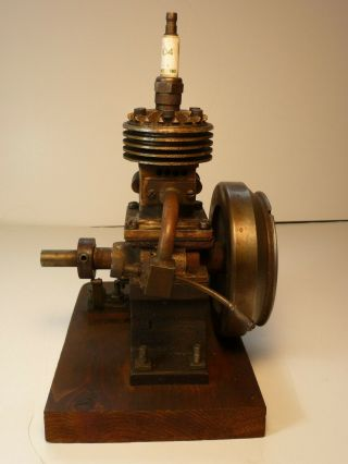 Vertical hit miss gas engine Rare Early Model 9 inches tall mounted 3