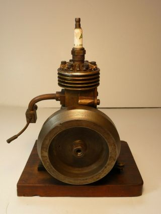 Vertical hit miss gas engine Rare Early Model 9 inches tall mounted 4