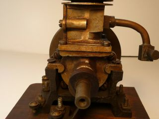 Vertical hit miss gas engine Rare Early Model 9 inches tall mounted 7