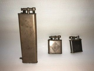 Vintage Dunhill Lift Arm Cigarette Lighters (2 Units) And One Unknown Lighter